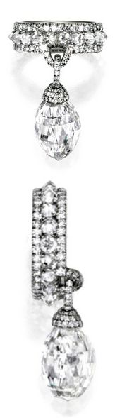 PLATINUM AND BRIOLETTE DIAMOND RING, JAR, PARIS The briolette diamond weighing 10.28 carats, suspended from a band set with 20 rose-cut and numerous single-cut diamonds, size 3¼, unsigned, with workshop marks and stamped PT950.