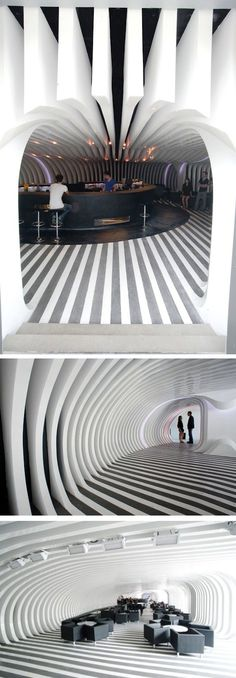 3gatti, the Shanghai-based practice established in 2002 by an Italian architect Francesco Gatti has realised this cavern-like monochrome interior of a music bar located in the same eastern Chinese city