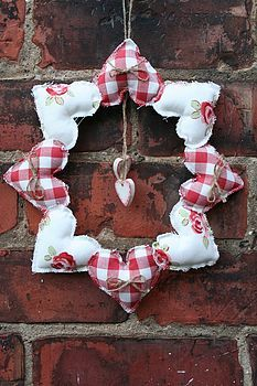 Handmade  Heart Wreath . make something like this with less hearts. maybe if i try this it will work better?  (Hearts are also less puffy, with raw edges)