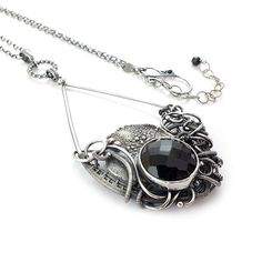 Hey, I found this really awesome Etsy listing at https://www.etsy.com/listing/239290059/wire-wrapped-necklace-black-necklace