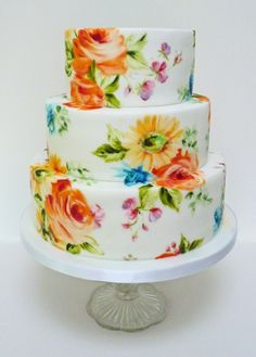 Bright wedding cake - This is a painted cake using the lowers for the wedding, They were nice and bright with orange roses, yellow gerberas and pink and purple sweet pea.