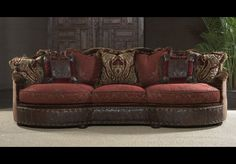 Luxury red burgundy sofa or couch. Bernadette Livingston Furniture offers a superb collection of high end furniture and furnishings. Custom details and quality seldom offered even by the largest retailers or pricey interior decorators