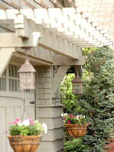 love this way to jazz up the garage exterior with a pergola and brackets