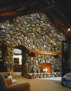Stone fireplace/divider wall