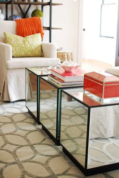 Mirrored coffee tables with pops of orange  Marie Flanigan Interiors  www.marieflanigan.com