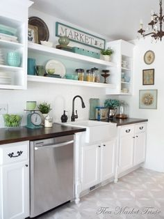 My dream kitchen. White, cabinets, farmhouse sink, shelves, vintage accessories, dark countertop.
