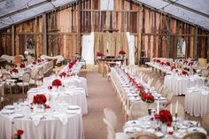 Pop up barn reception with red rose centerpieces