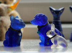 """Toy hoarding aside, the primary purpose of my trip to Denmark was for a family reunion involving my family, dad and Danish cousins from Copenhagen and the Jutland Peninsula.  But it was also an opportunity for toy reunions.  Pictured here is a trio of glass """"cracker"""" charms manufactured in Austria (now the Czech Republic) around 100 years ago.  The bulldog and the rabbit were purchased here, by me.  My son's girlfriend found the dachshund in a Viennese flea market.  They look big in the…"""