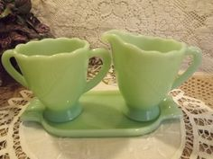 "Not ""vintage from the 1960s"".  Not made by McKee.  New sugar, creamer and tray set by Mosser, made in the 21st Century.  Sells for about $35 new, or used on Ebay for less than half that price."