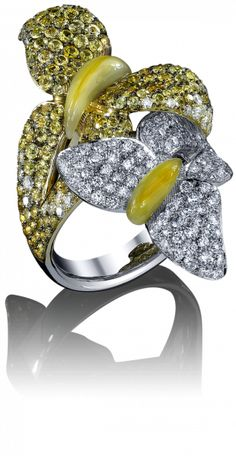The wings of these delicate butterflies come alive with gemstones of soft, incandescent gradated colors, centered by fluid bodies in a living sculpture of movement and vibrancy. This lovely ring features natural yellow sapphire and white diamonds.