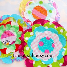 Love these layered flower appliques.