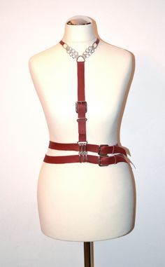 Red leather harness with buckles, chain collar and double belt https://kivaleatheraccessories.wordpress.com/2015/01/20/cool-leather-harnesses-by-kiva/