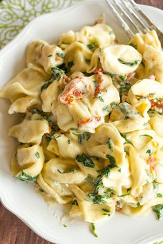 Tortellini in Parmesan-Cream Sauce with Spinach and Sun-Dried Tomatoes - An easy, AMAZING dinner ready in less than 30 minutes! Perfect for a weeknight meal or your next dinner party.