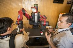 Speaker Rodney Brooks of Rethink Robotics introduced us to Baxter on the stage, and then let people interact with him.