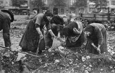 1918. German women looking in the trash after the war in Germany