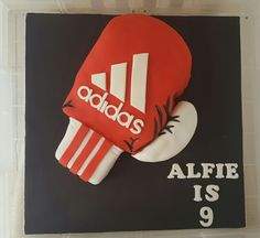 Red adidas boxing glove cake