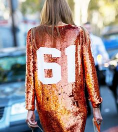 Orange sequin jersey-inspired dress.  // Photo: The Stylograph #PFW #streetstyle