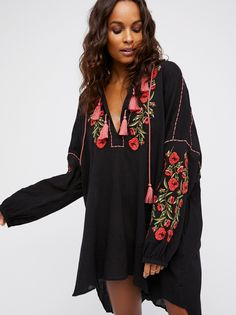 Willow Shirt Dress | Boho-inspired shirt dress featuring beautiful floral embroidery throughout and a soft V-neckline with cute tassel accents.    * Effortless, shapeless fit   * Semi-sheer, crinkly fabrication   * Hook-and-eye closures at the neckline   * Hidden side pocket details   * Elastic at the sleeve cuffs