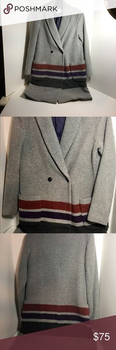 Steven Alan Shawl Collared Blanket Coat Steven Alan Shawl Collared Blanket Coat. Light grey with red, purple and charcoal stripe around the bottom of coat. Two button closure, one inside button closure. Bluish purple lining. 70% wool, 15% polyester and 15% polyacrylic. Made in USA. These are used items, so please be realistic and do not expect a perfect item. In very good condition. Steven Alan Jackets & Coats