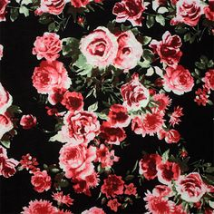 """Red Pink Roses Photos on Black Cotton Jersey Blend Knit Fabric - Pink and red roses that looks like they are photographed on a black cotton jersey rayon blend knit.  Fabric is soft with a smooth hand, light weight.  Largest rose measures 2 1/2"""" for scale.  ::  $6.00"""