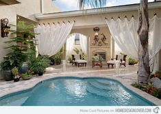 Those curtains @ 15 Relaxing and Dramatic Tropical Pool Designs   Home Design Lover