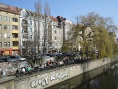 Berlin-Kreuzberg.  Hip and trendy but still enough for tourists, Kreuzberg is a great area to explore street art, indie shops selling clothes and music, not to mention some killer doner kebabs for cheap prices