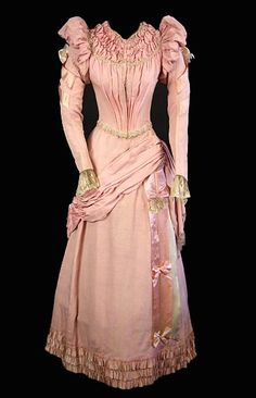 Pretty pink dress with great neckline and sleeve details.  I'm guessing at its age.  Let me know if anyone can pinpoint a date. (P8ronella says 1890-1900) (Karen Heim says 1890s-1893 onwards, after the collapse of the big sleeves.)