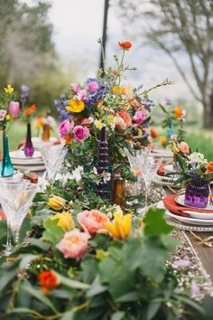 Love these colors and the colored glass, but we won't be doing this many flowers on the tables.