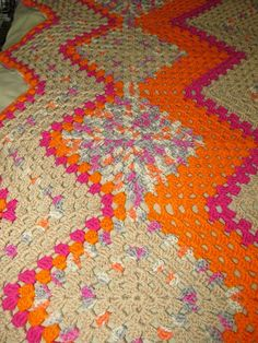 Granny & Granny Ripples Afghan (with free pattern). Join the squares diagonally, at their corners & then crochet 'ripples' on either side.