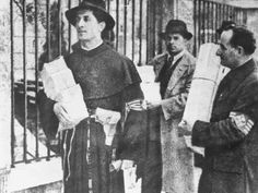 """Arrow Cross """"Killer Priest"""" Andras Kun in his cassock confiscating Jewish belongings. He ordered his death squads to kill Jews """"in the holy name of Christ."""""""