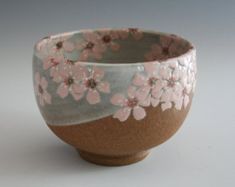 handmade stoneware bowl or chawan or with pink sakura / cherry blossoms in…