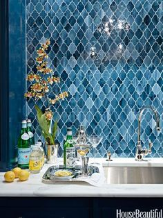 Moroccan backsplash tiles in a classy bar. HouseBeautiful.