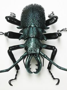 "Here's a green beetle from a collection of insect sculptures by a Flickr user named ""Bugmaker"""