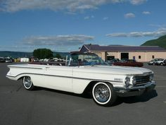 1960 Oldsmobile 98 Convertible. This beauty was 20 feet long and weighed 4,400 lbs. It had glove leather upholstery and four cigarette lighters. Only 7,284 were manufactured.