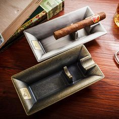 Luxury Copper Cigar Ashtray Creative Design Luxury Cigar Ashtray Material: Metal Size: Weight: Packing with Black box brand newelegant and modern design Cigar in the picture is not for sale Gadgets electronics phones watches gifts technology gizmos smart Whisky, Cigars And Whiskey, Whiskey Gifts, Cuban Cigars, Cigar Shops, Cigar Bar, Cigar Holder, Cigar Ashtray, Cigar Cases