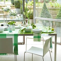 The zingy green and white tableware and moss green runners reflect the garden outside this conservatory. Tall stems in glass bottles are teamed with posies of white flowers and lush green leaves gathered in glasses. Green Dining Room, Country Dining Rooms, Green Table, Dining Room Design, Dining Area, Fresco, Modern Conservatory, Green Centerpieces, Living Room Images