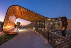 An immense wooden barrel open over the green mountains of Belo Horizonte: this is the scenario designed by GPA&A office of the architect Gustavo Penna to hos...