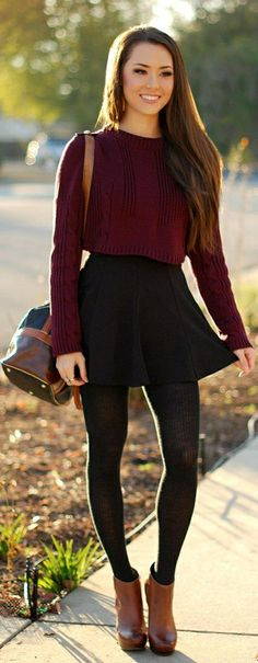 Fall Outfit Inspiration; Maroon Crop Top Slouch Sweater, Black High-Waisted Mini Skater Skirt, Black Tight Leggings.