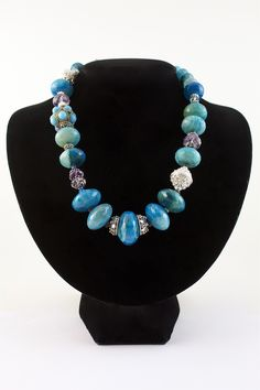 """""""Bora Bora Blues"""" This necklace is chock full of good stuff.  Blue Agate, Amethyst, Sterling Silver bead caps and Pewter adornments.  Easy to use toggle in the back.  Price: $168.00.  #spitfire designs jewelry"""