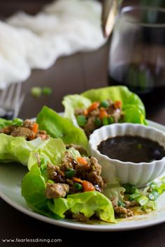 Love P.F. Chang's Lettuce Wraps? Here is a tangy copycat Gluten Free Asian Lettuce Wraps. Ground turkey lettuce wraps. How to make gluten free lettuce wraps. Gluten free, dairy free.