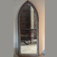 """Gothic Arched Window Framed Mirror  This antique window frame has been repurposed as a mirror frame. A pair of slightly smaller mirrors also available.  96""""H x 37""""w x 4""""d"""