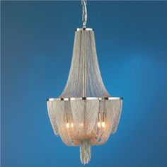 """Above bed Mesh Curtain Chandelier Tiny mesh chains drape like elegant drapery from a Polished Nickel frame creating a traditional shaped chandelier with a modern edge.  6x60 watts (G9 Xenon halogen bulbs included)  (24""""Hx14""""W)  3' chain  5"""" canopy  40"""" cord   Product SKU: CH12033 PN Price:  $899.00  Quantity"""