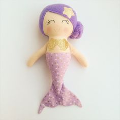 This beautiful handmade mermaid doll is made with love! She is about 14 inches tall and made from high quality cotton fabrics and wool blend felt accessories. Her face is hand embroidered and detailed with cute rosy cheeks and a starfish in her hair. Contact me if you would like to customize your own doll! PLEASE NOTE ❤ Dolls are made with small materials that may not be suitable for children under the age of three. I encourage supervised, gentle play with our dolls. They look beautiful…