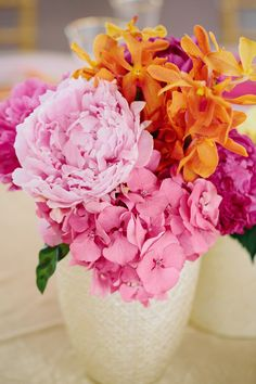 #Pink #Orange #Centerpiece | On SMP - http://www.StyleMePretty.com/massachusetts-weddings/2014/01/08/belle-mer-wedding/ Anna Wu Photography