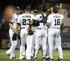 Game #112 8/6/12: San Diego Padres players high-five after beating the Chicago Cubs 2-0 in a baseball game at Petco Park on August 6, 2012 in San Diego, California. (Photo by Denis Poroy/Getty Images)