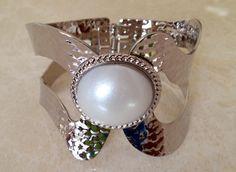 Ivory Coast Bangle Bracelet, Striking bangle bracelet, hammered with pearlesque setting.