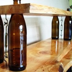 Cool idea for a shelf, especially in a bar using wine bottles! Bottle reuse decorating ideas