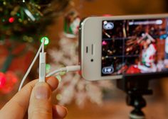 great list of iPhone photography tips for the holidays -- I had no idea you could use your headphones as a camera remote!