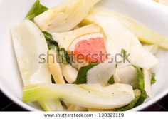 Approved yesterday, sold today at Shutterstock : Bowl with salad of fennel, pears and white cheese together with smoked salmon.
