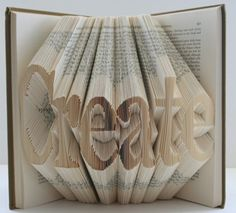 Remember those Christmas trees made out of TV Guide and Readers' Digest?  This takes book folding to another level!